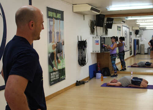 trying yoga for the first time. getting in to yoga for men. Joe checks out the competition in his first yoga class.