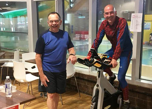 Pete encourages Duty Manager, Tony on the Spinathon bike for the BHF